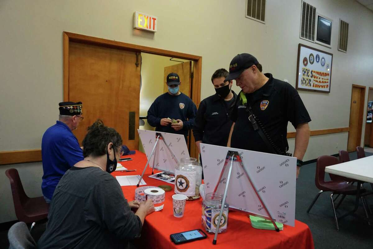 Firefighters from Harris County Emergency Services District No. 48 give their payments for Breakfast with Our Veterans on Saturday, April 3, at the Katy Elks Lodge 2628 in Katy.