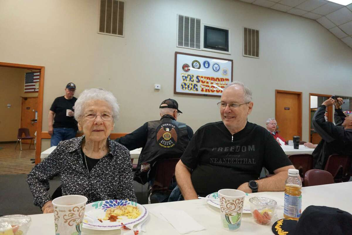 Thelma Williams, 102-year-old Women's Army Corps veteran, and her son, Richard Williams, a Navy veteran, enjoy conversation at Breakfast with Our Veterans on Saturday, April 3, at the Katy Elks Lodge 2628 in Katy.