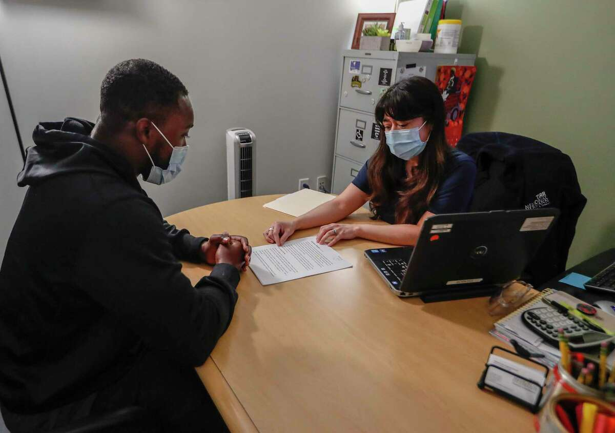 Former Texans player Andre Hal, 28, works with Veronica Garcia-Lechuga a speech pathologist at TIRR, Wednesday, March 24, 2021. When Hal started having issues with his speech and balance, he was beyond concerned. He thought the cancer he had beaten in 2018 was back. Instead, he was diagnosed with a rare condition called CNS vasculitis which causes inflammation of the blood vessel walls around the brain.With the help of steroid medication, he felt better. And after working with speech therapy with Garcia-Lechuga, he's back to work, finishing up his MBA at UH and waiting for the release of his new book.