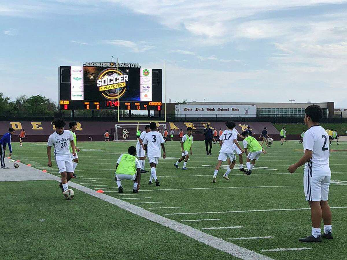 The Elsik boys soccer team warms up before its Region III-6A area playoff match against Kingwood at Abshier Stadium in Deer Park.