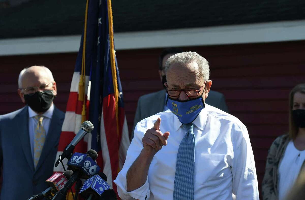 U.S. Senate Majority Leader Charles Schumer announces that state restaurants are now eligible for their own, direct federal pandemic relief, as part of the American Rescue Plan he led to passage in the Senate on Tuesday, April 6, 2021, at Russo's Grill in Amsterdam, N.Y. The Senator was joined by U.S. Rep. Paul Tonko, left, Amsterdam Mayor Michael Cinquanti and local leaders, restaurant owners and residents. (Will Waldron/Times Union)