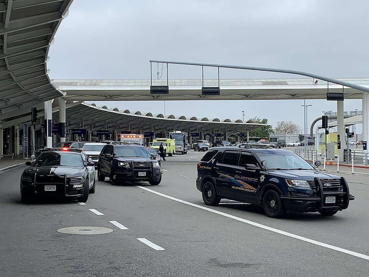 Alameda County officials evacuated Terminal 1 at Oakland International Airport Tuesday morning as sheriff's deputies and crisis negotiators worked with a man they said was suicidal and threatening to harm himself with a knife.