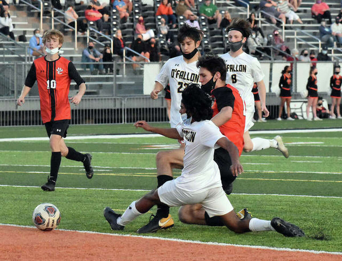 Edwardsville's Brennan Weller has his shot blocked by an O'Fallon defender Vishal Jacob late in the first half of Monday's Southwestern Conference game in Edwardsville.