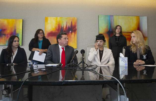 Ashley Solis, second right, the first alleged victim of the sexual assault allegations against Houston Texans quarterback Deshaun Watson gives a statement during a news conference with attorney Tony Buzbee and his legal team Tuesday, April 6, 2021, in Houston. Photo: Yi-Chin Lee/Staff Photographer / © 2021 Houston Chronicle