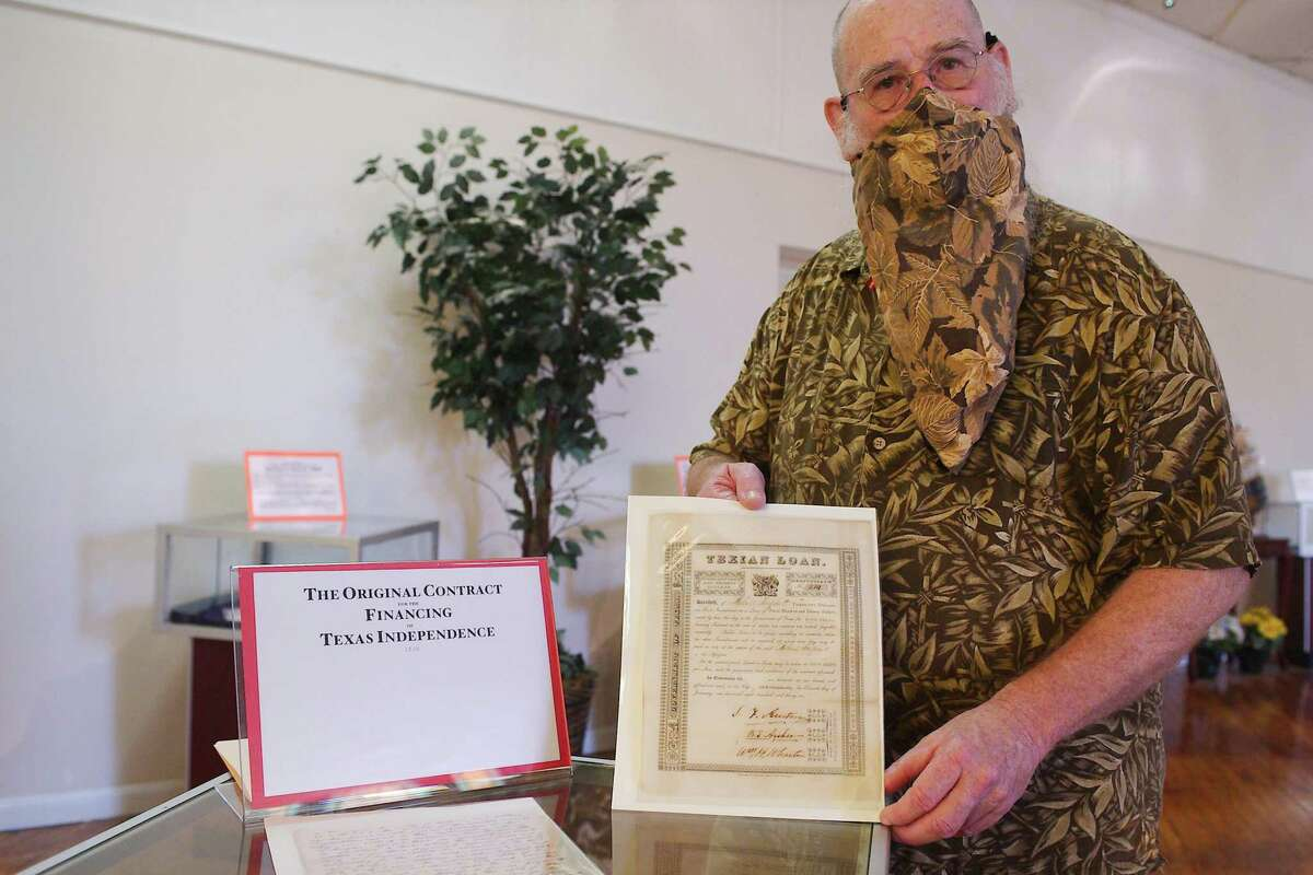 Sam Tanksley of the Karpeles Manuscript Library Museum in Alvin holds an original manuscript of a financing document for Texas Independence, one of various original and reproduced documents from Texas history held at the museum.