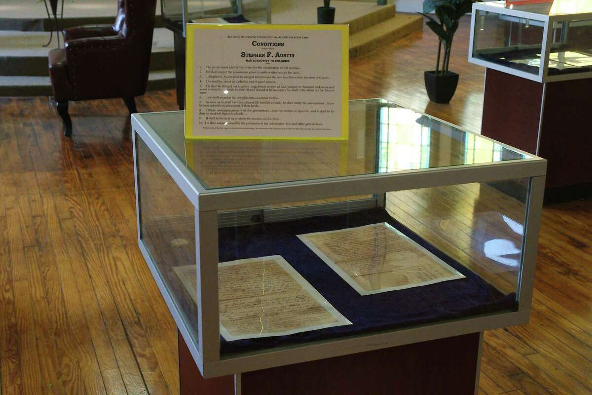 A document outlining the conditions under which Stephen F. Austin could colonize Texas sits in a glass display case at the Karpeles Manuscript Library in Alvin.