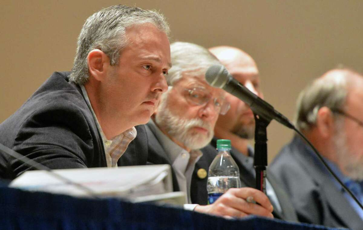 Common Council Finance/Claims Committee member John Kydes listens to residents speak up during a public hearing on Thursday February 22, 2018 in Norwalk Conn.