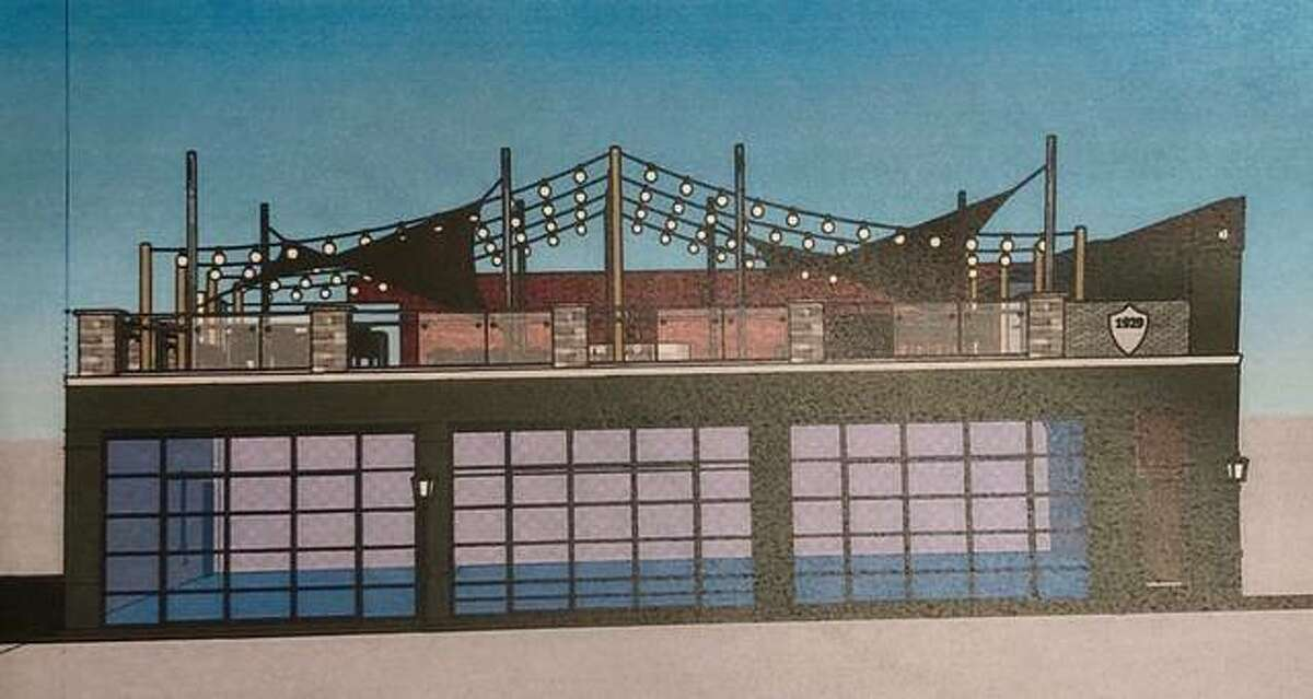 This artist's rendering illustrates developers Tom Declue III and Mark Wadlow's concept for 7 N. Wood River Ave. as a rooftop restaurant. Wood River officials on Monday accepted their $1 bid for the fire-damaged structure.