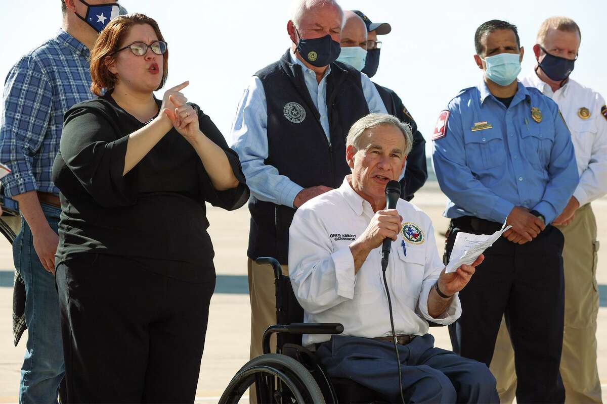 Texas Governor Greg Abbott gives an update on the state's efforts to provide water and other resources to communities around Texas in the aftermath of last week's winter blast at Port San Antonio on Sunday, Feb. 21, 2021 .