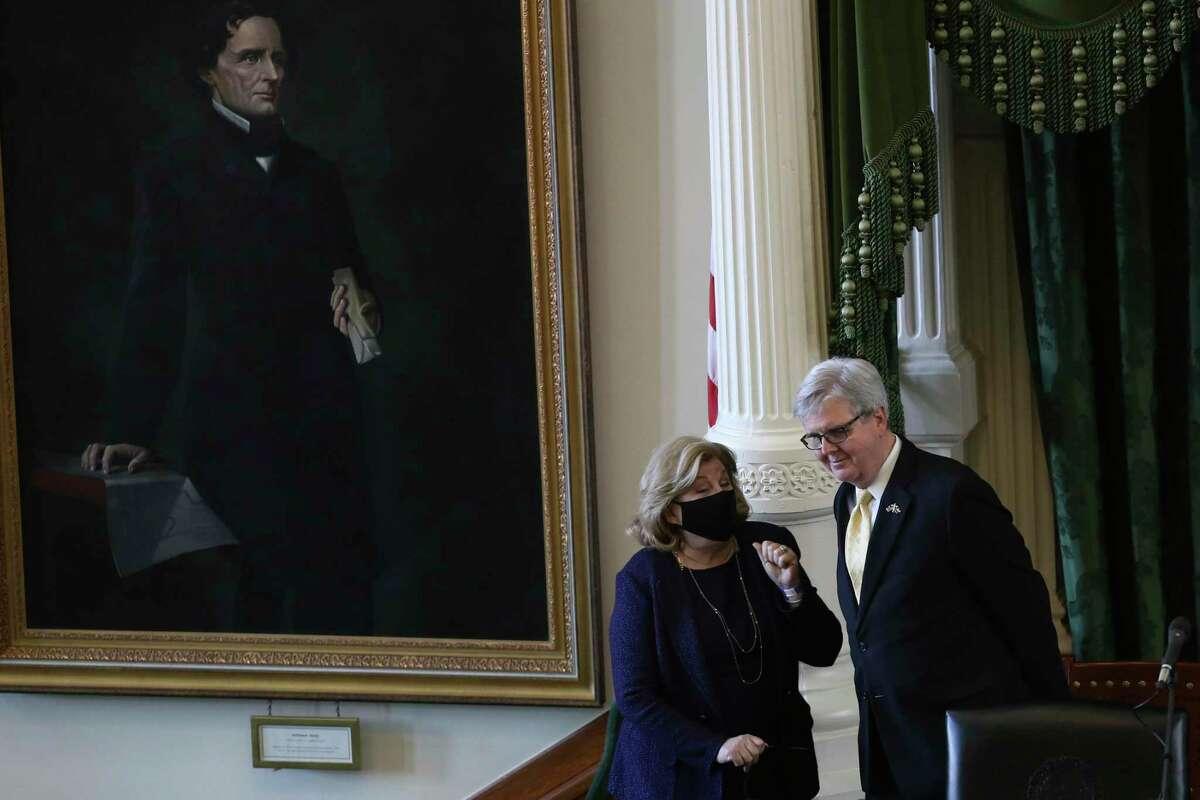Texas State Sen. Jane Nelson, R-Flower Mount, talks with Lt. Gov. Dan Patrick as the 87th legislature reconvenes, Tuesday, Feb. 9, 2021. On their left is a portrait of Confederate President Jefferson Davis.