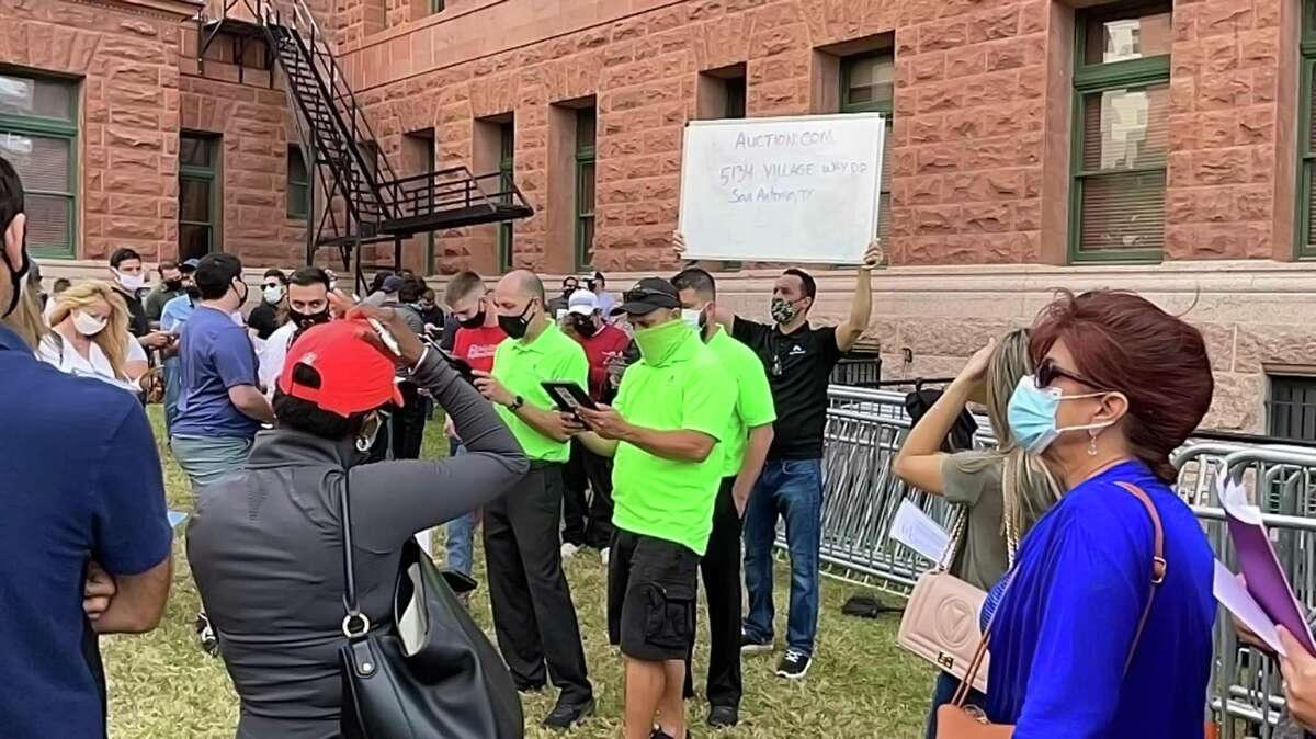 More than 200 people assembled on the grounds of the Bexar County Courthouse Tuesday for mortgage and tax foreclosure sales.