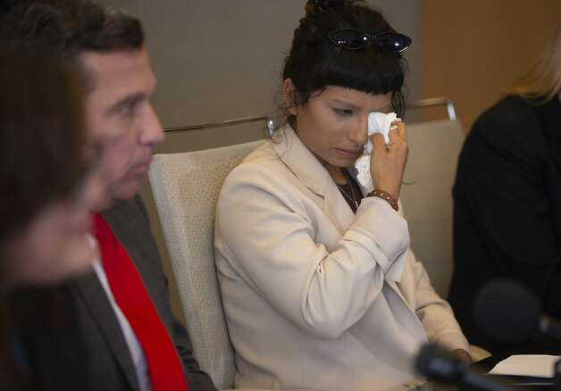 Ashley Solis, the first woman to file sexual assault claims against Houston Texans quarterback DeshaunWatson, wipes away tears during a news conference Tuesday, April 6, 2021, in Houston. Photo: Yi-Chin Lee/Staff Photographer / © 2021 Houston Chronicle