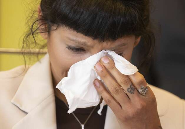 Ashley Solis, the first accusor of the sexual assault allegations against Houston Texans quarterback DeshaunWatson, wipes away tears while giving her statement during a news conference Tuesday, April 6, 2021, in Houston. Photo: Yi-Chin Lee/Staff Photographer / © 2021 Houston Chronicle