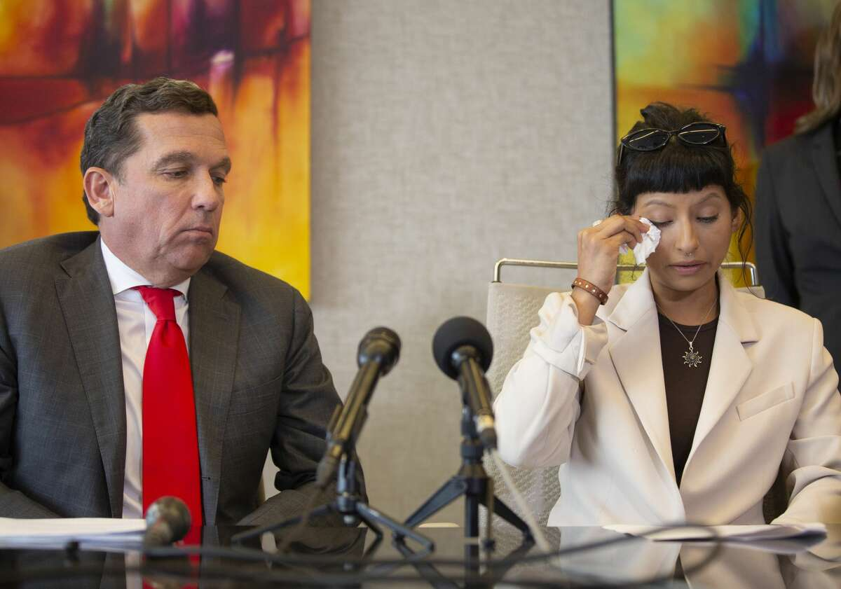 Ashley Solis, the first accusor of the sexual assault allegations against Houston Texans quarterback DeshaunWatson, wipes away tears while giving her statement during a news conference Tuesday, April 6, 2021, in Houston.