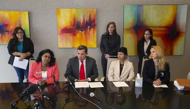 Ashley Solis, second right, the first accuser of the sexual assault allegations against Houston Texans quarterback DeshaunWatson, gives her statement during a news conference Tuesday, April 6, 2021, in Houston. Solis was accompanied by attorney Tony Buzbee, his legal team and experts. Photo: Yi-Chin Lee/Staff Photographer / © 2021 Houston Chronicle