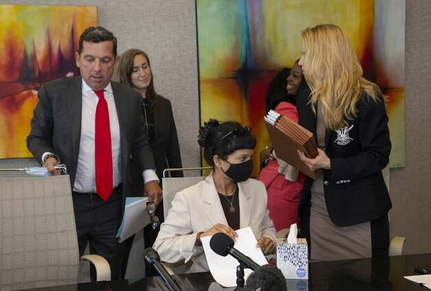 Ashley Solis, the first accuser of the sexual assault allegations against Houston Texans quarterback DeshaunWatson, gets up to leave following a news conference Tuesday, April 6, 2021, in Houston. Photo: Yi-Chin Lee/Staff Photographer / © 2021 Houston Chronicle