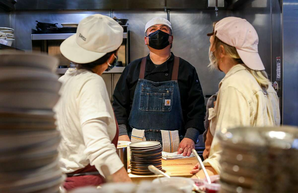 Stephanie Reagor, left, a co-partner, head cook Omar Aviles, and Emma Lipp, also a co-partner, work in the kitchen during the dinner shift at Valley Bar & Bottle, a new wine shop, bar, and restaurant, on Friday, March 12, 2021, in Sonoma, Calif.