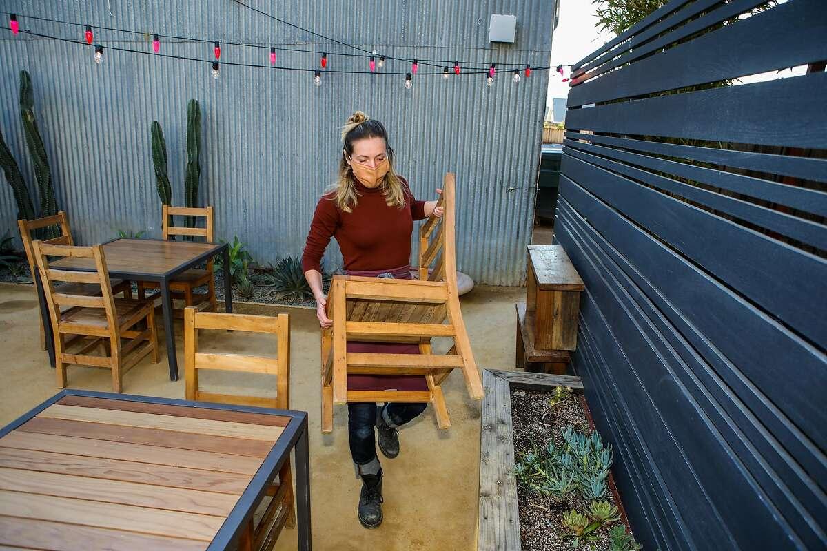Co-partner Lauren Feldman prepares for dinner last month at Valley Bar & Bottle, a Sonoma wine shop, bar and restaurant.