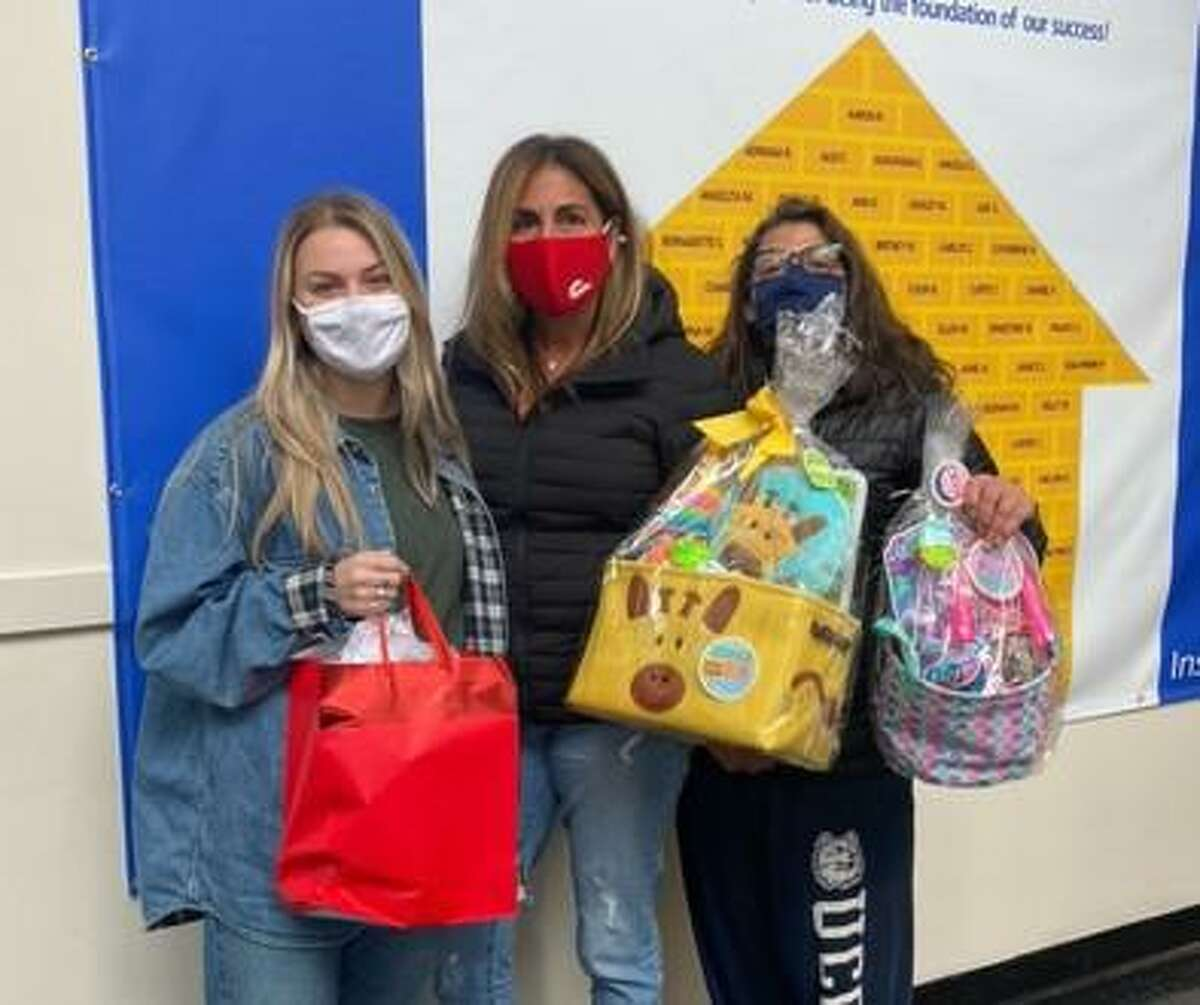 Shelton-based DiMatteo Group Financial Services presented a total of 75 Easter baskets to children at three shelters in lower Fairfield County.