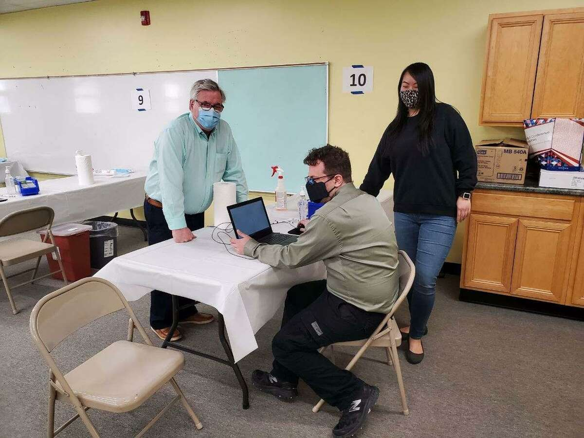 First Selectman Steve Dunn (left) visits the St. Joe's clinic before it opens for appointments. The clinic is moving from the town's senior center to be able to do more vaccinations each day that it's open.