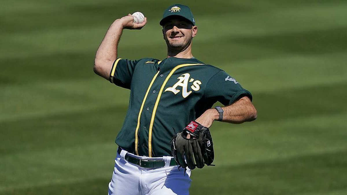 Oakland Athletics relief pitcher Burch Smith during a spring training baseball game against the Los Angeles Angels, Friday, March 5, 2021, in Mesa, Ariz. (AP Photo/Matt York)