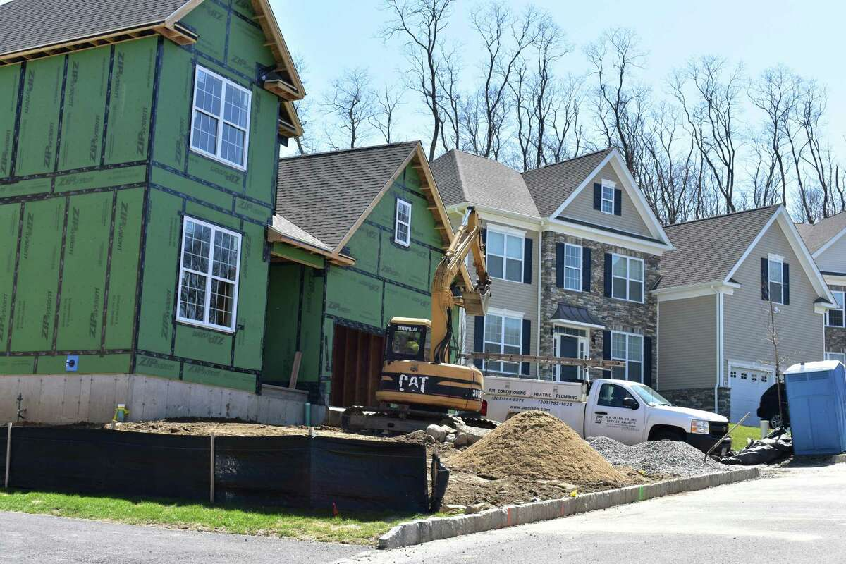 A construction crew builds a new unit in April 2021 at Toll Brothers' Bethel Crossing development in Bethel, Conn. Home ownership remains below levels exiting the Great Recession, despite historically low interest rates.