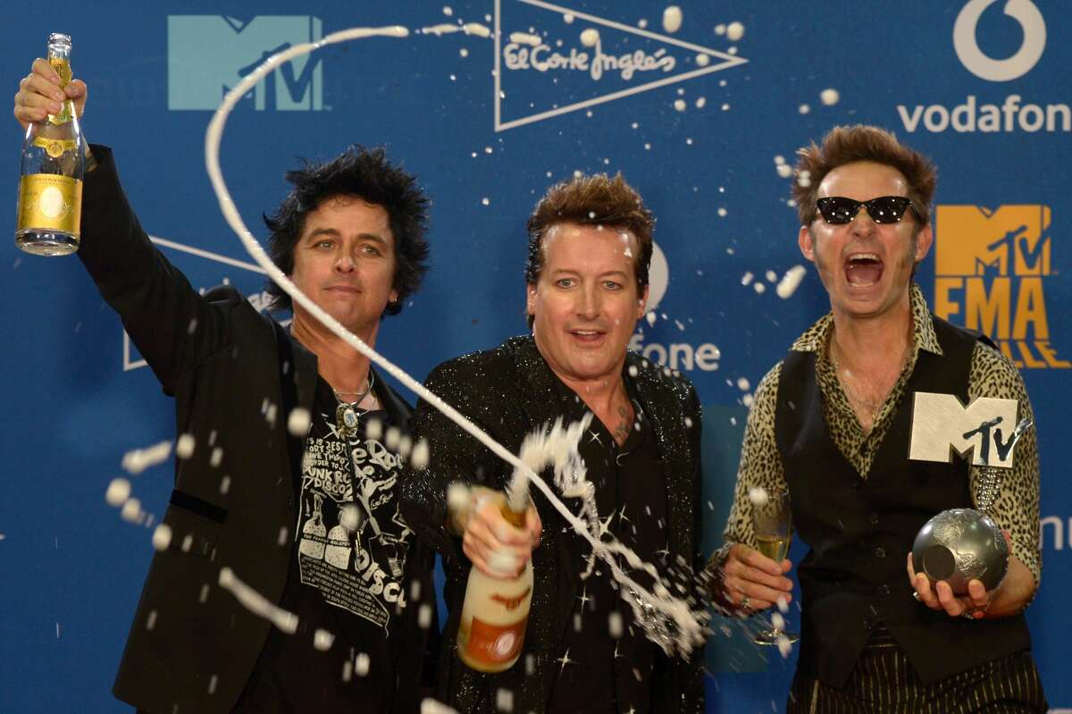 Members of US rock band Green Day pose with their Best Rock Artist award during the MTV Europe Music Awards at the FIBES Conference and Exhibition Centre of Seville on November 3, 2019. (Photo by CRISTINA QUICLER / AFP) (Photo by CRISTINA QUICLER/AFP via Getty Images)