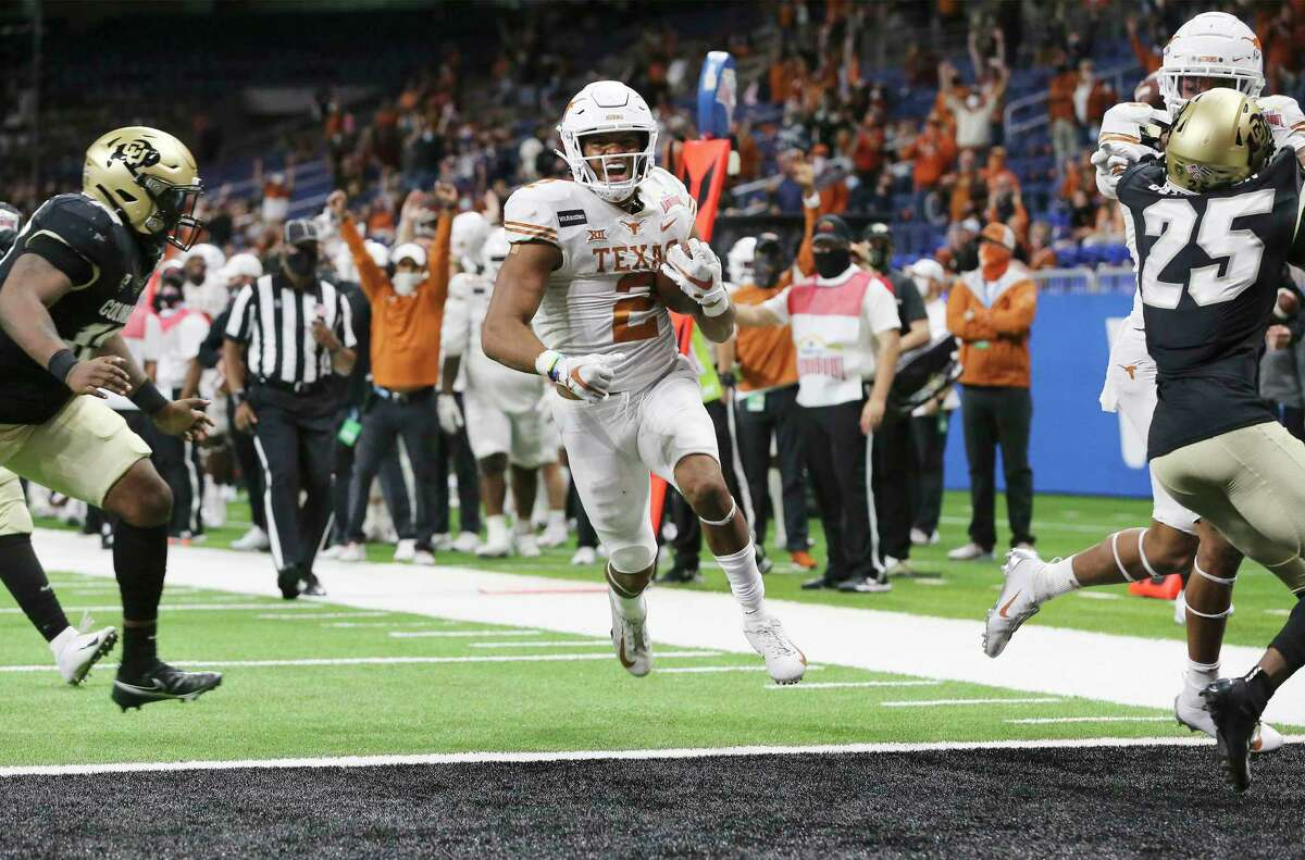 Roschon Johnson, recruited to UT as a quarterback, moved to running back to bolster depth. Johnson performed so well that the coaches kept him as a complement to star Bijan Robinson.