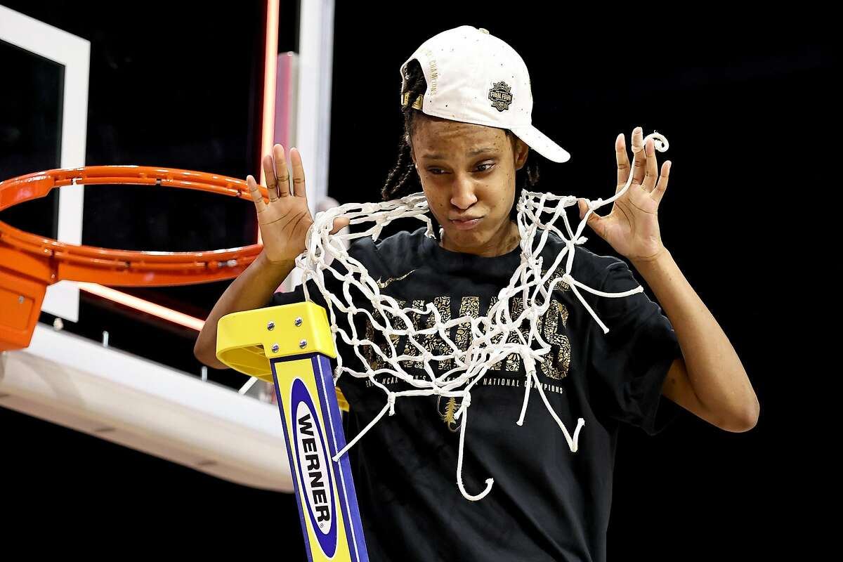 Stanford's Kiana Williams celebrates after cutting down the net following the team's win against the Arizona Wildcats in Sunday's national championship game.