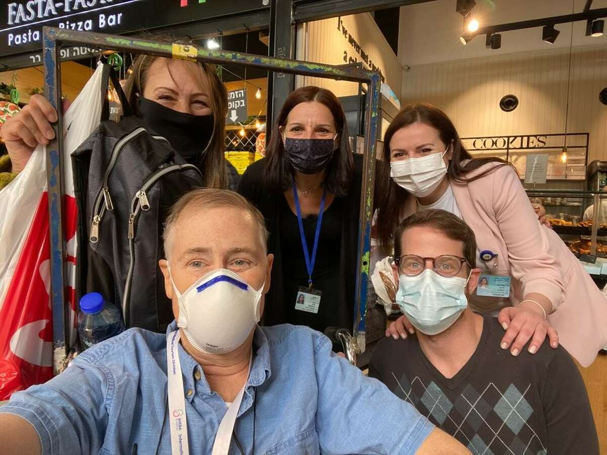Brian McGarry (far left) and his wife Patty (above him) with team of organizers from Sheba Medical Center in Israel. McGarry, a Schenectady County legislator from Rotterdam, is in Israel to receive a specialized prostate cancer regimen not available in the U.S.