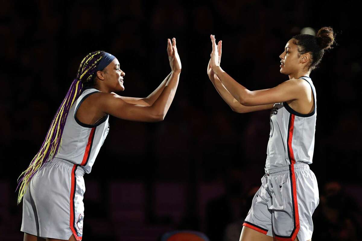 SAN ANTONIO, TEXAS - APRIL 02: Aaliyah Edwards #3 of the UConn Huskies and Olivia Nelson-Ododa #20 during intros prior to the first quarter against the Arizona Wildcats in the Final Four semifinal game of the 2021 NCAA Women's Basketball Tournament at the Alamodome on April 02, 2021 in San Antonio, Texas. (Photo by Elsa/Getty Images)