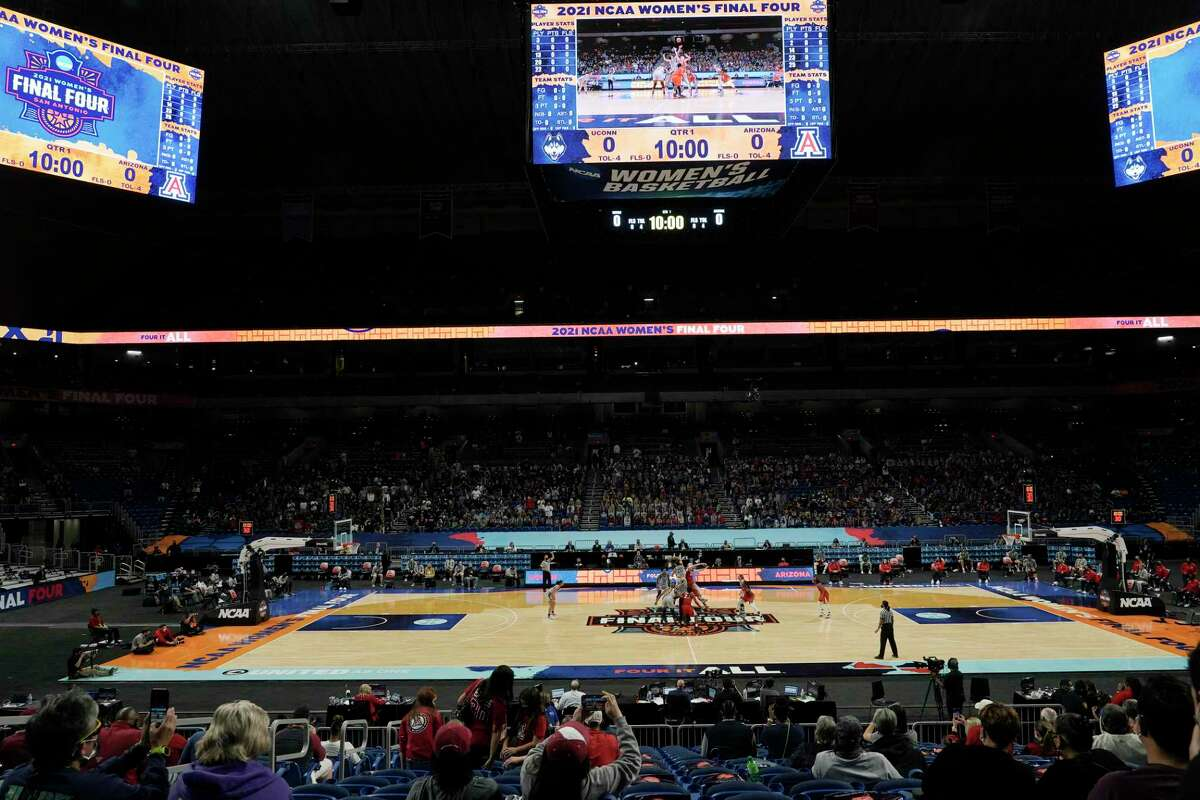 Players get set for the opening tipoff during the first half of a women's Final Four NCAA college basketball tournament semifinal game between Connecticut and Arizona Friday, April 2, 2021, at the Alamodome in San Antonio. (AP Photo/Morry Gash)