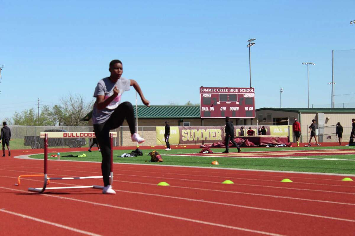 Summer Creek's Morgan Taylor practicing relays and hurdles preparing for the District 21-6A meet.