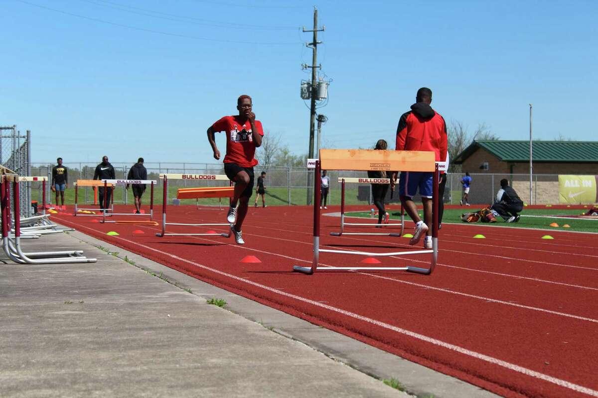 Summer Creek's Barry Richards running hurdles at practice.