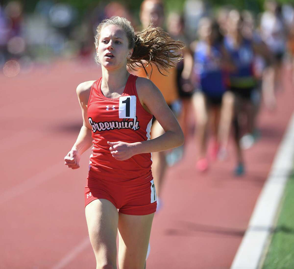 Greenwich's Mari Noble wins the 1600 at the FCIAC Outdoor Track and Field Championship at Southern Connecticut State University in New Haven in 2019.