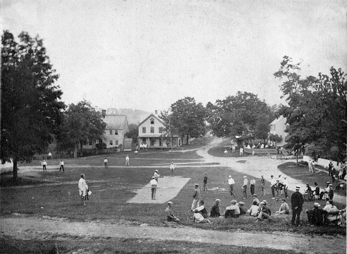 Baseball on the Washington Green in 1869, in one of the first photographs of a baseball game in progress.
