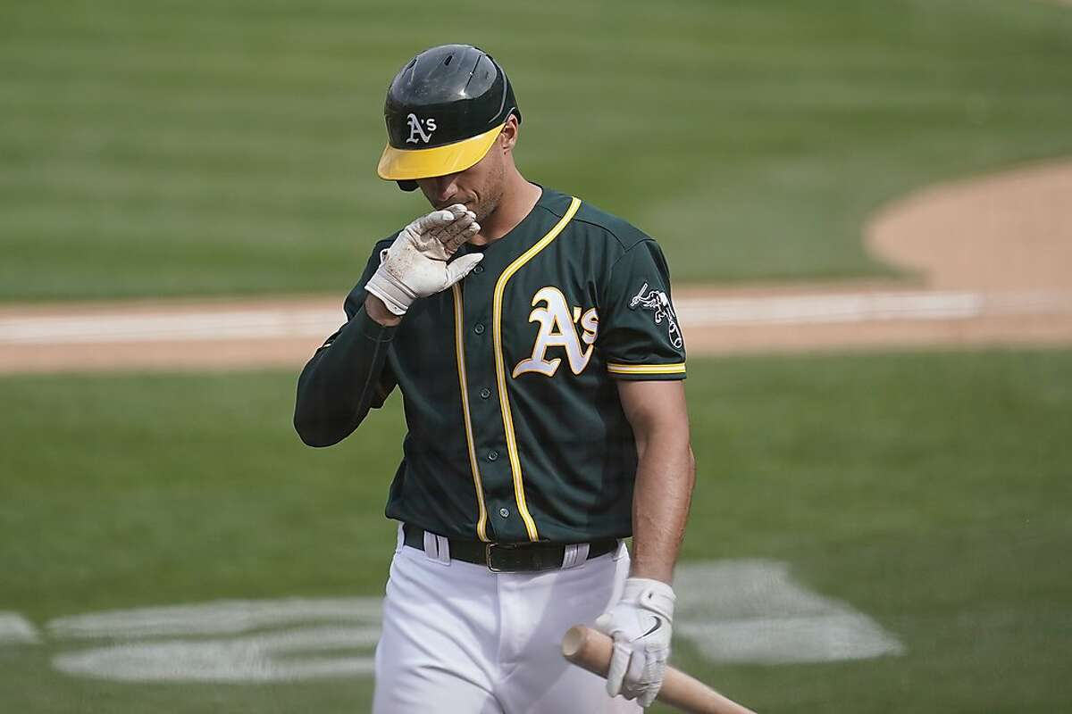 Oakland Athletics' Matt Olson walks to the dugout after striking out against the Houston Astros during the eighth inning of a baseball game in Oakland, Calif., Sunday, April 4, 2021. (AP Photo/Jeff Chiu)