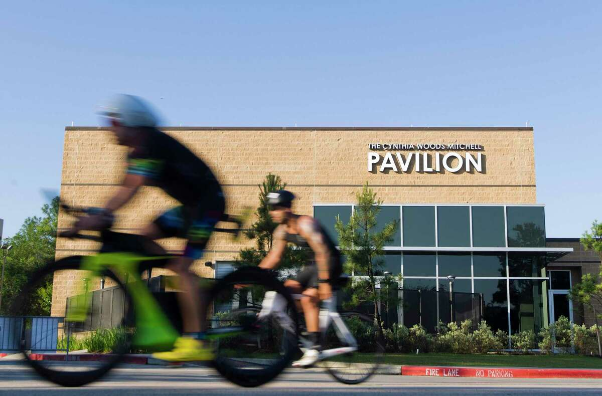 And, in a separate announcement issued by Visit The Woodlands at nearly the same time as the Ironman news, the race's parent company and Visit The Woodlands have agreed to a new contract keeping the world-renowned triathlon in the township through 2025. Triathletes pass The Cynthia Woods Mitchell Pavilion during in the annual Ironman triathlon, Saturday, April 27, 2019, in The Woodlands.