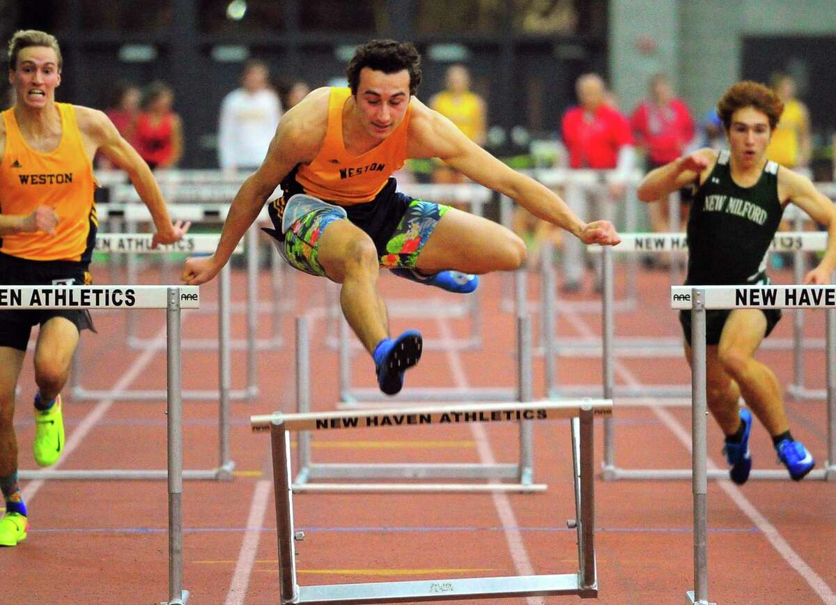 Weston's John Cassol competes in the hurdles final during SWC Indoor Track and Field Championship action in New Haven, Conn., on Saturday Feb. 8, 2020.