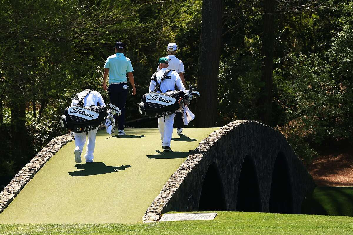AUGUSTA, GEORGIA - APRIL 05: Matt Jones of Australia and Will Zalatoris of the United States walk across the Hogan Bridge on the 12th hole during a practice round prior to the Masters at Augusta National Golf Club on April 05, 2021 in Augusta, Georgia. (Photo by Mike Ehrmann/Getty Images)