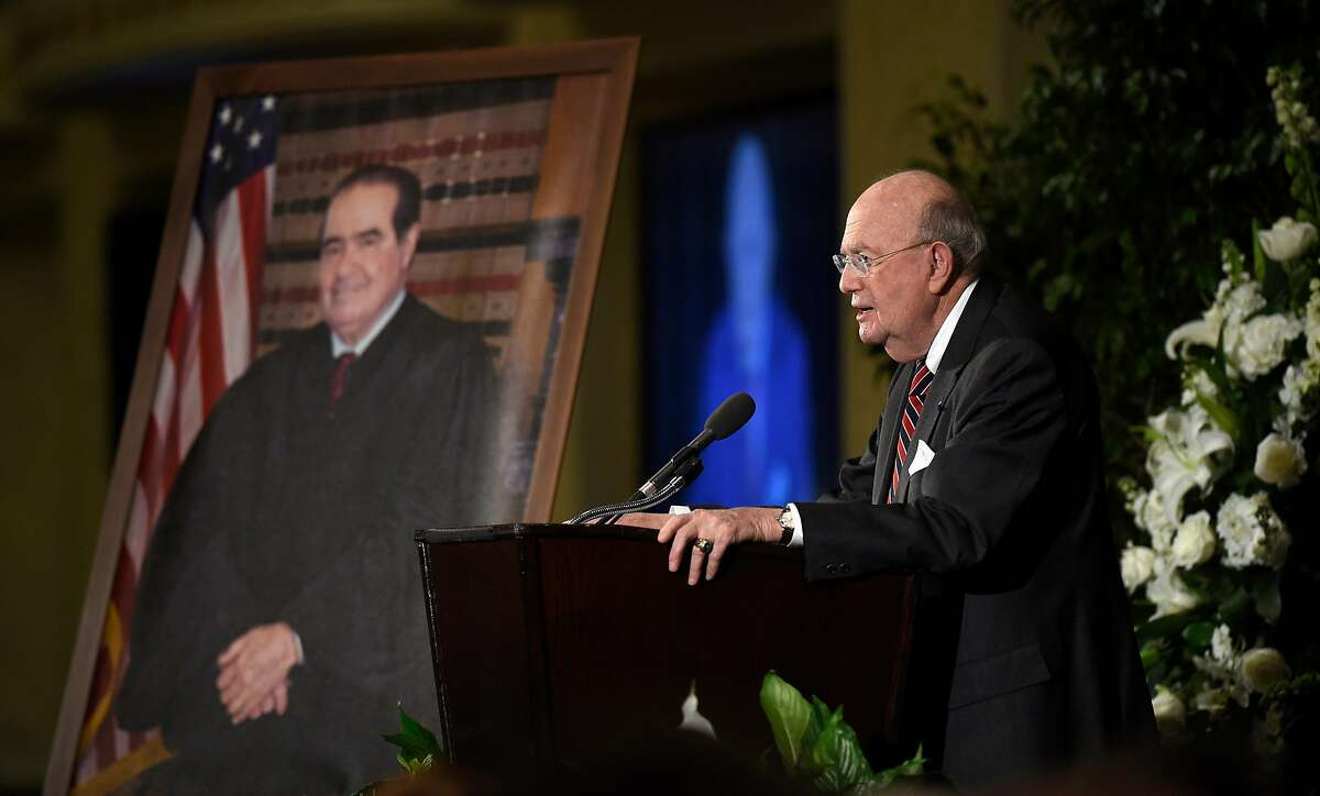 Judge Laurence Silberman, senior judge on the U.S. Court of Appeals for the District of Columbia Circuit, speaks at the memorial service for Supreme Court Justice Antonin Scalia in 2016. Silberman accuses most news media of liberal bias and calls for overturning of 1964 Supreme Court ruling setting tough standards for libel suits by government officials.