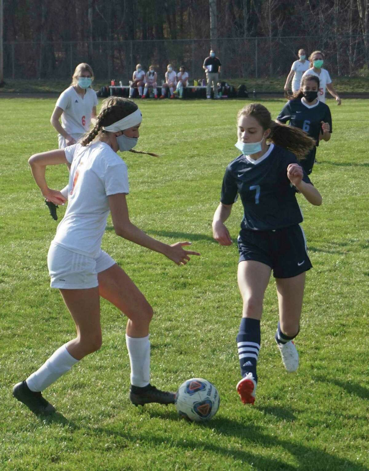 Crossroads freshman Kaitlin Buys (right) goes after the ball during CCA's loss to Cheboygan on Tuesday evening. (Pioneer photo/Joe Judd)