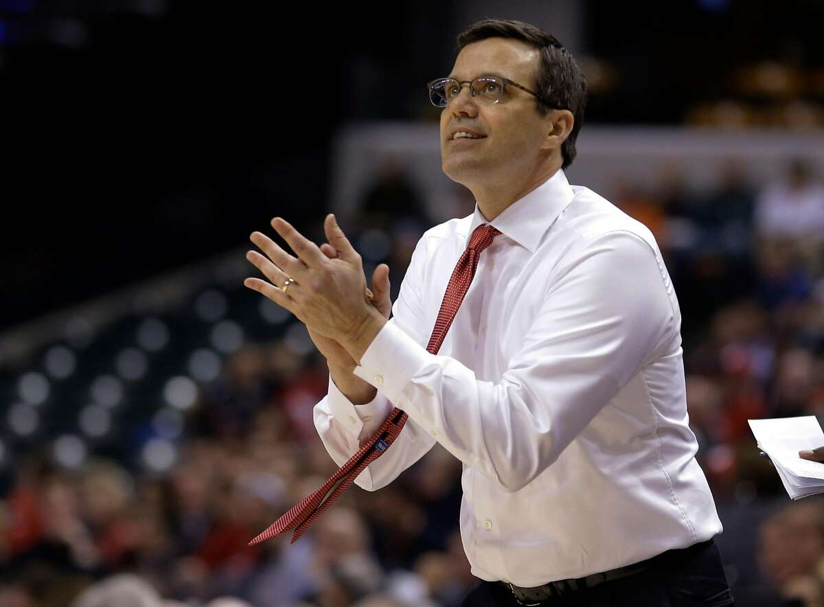 Nebraska's head coach Tim Miles reacts to a play in the second half of an NCAA college basketball game against Rutgers at the Big Ten Conference tournament, Wednesday, March 9, 2016, in Indianapolis. (AP Photo/Michael Conroy)