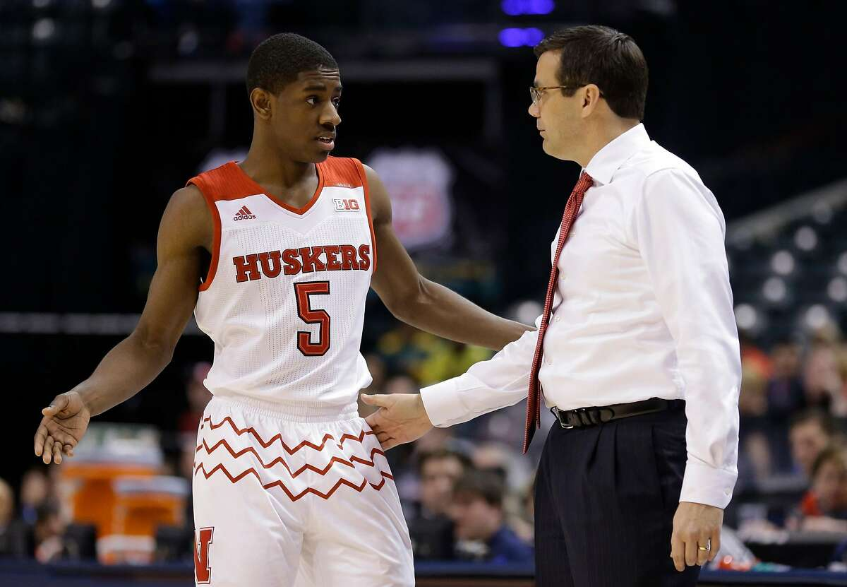 Nebraska's head coach Tim Miles talks to Glynn Watson Jr. (5) in the second half of an NCAA college basketball game against Rutgers at the Big Ten Conference tournament, Wednesday, March 9, 2016, in Indianapolis. (AP Photo/Michael Conroy)