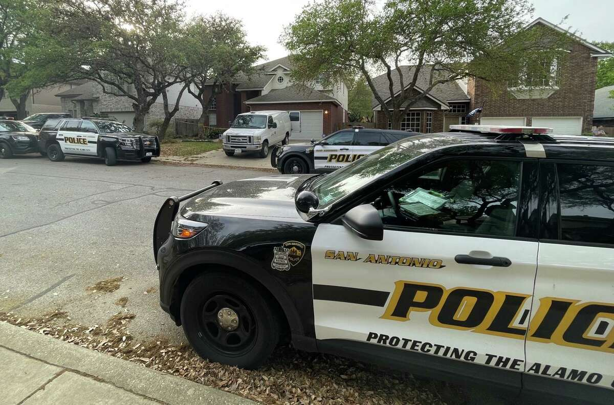 Police cars are seen Tuesday, April 6, 2021, outside a home in the 2000 block of Chittim Trail Drive where a man and a woman were found dead with gun shot wounds.