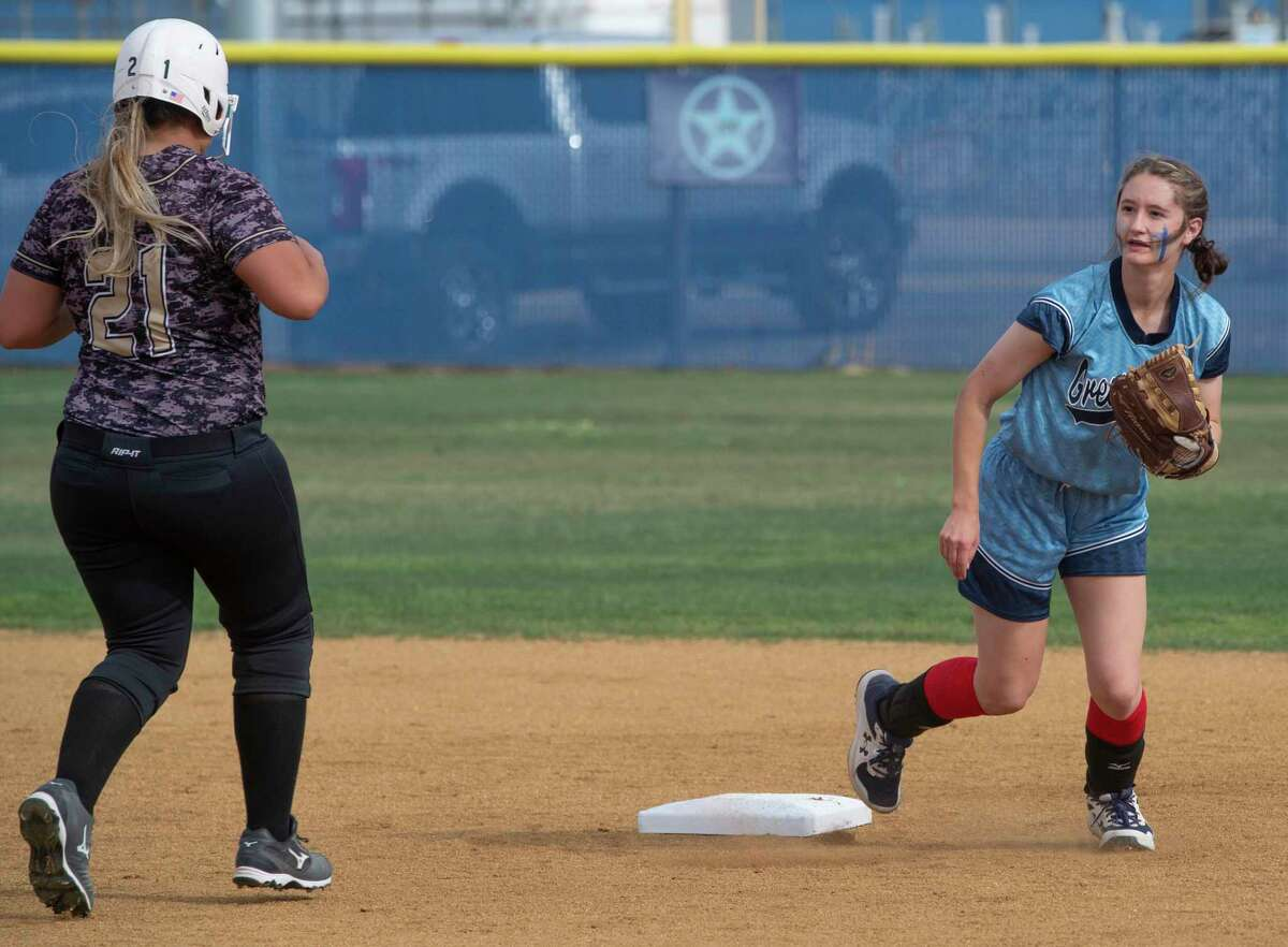 Greenwood's Shelby Matthews watches her throw to first after getting the force out at second on Andrews' Hailey Canava 04/06/21 at Greenwood High School. Tim Fischer/Reporter-Telegram