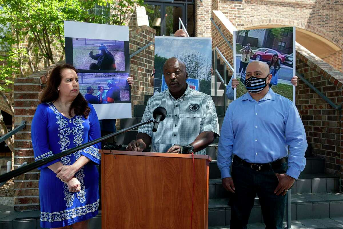 Officer Alonzio Hardin of the Black Police Officers Coalition stands next to Sharon Rangler and Rich Medina while addressing the media on Tuesday, April 6, 2021, about claims that signs have been stolen from those who do not support Proposition B, which would roll back police officers' right to bargain collectively.