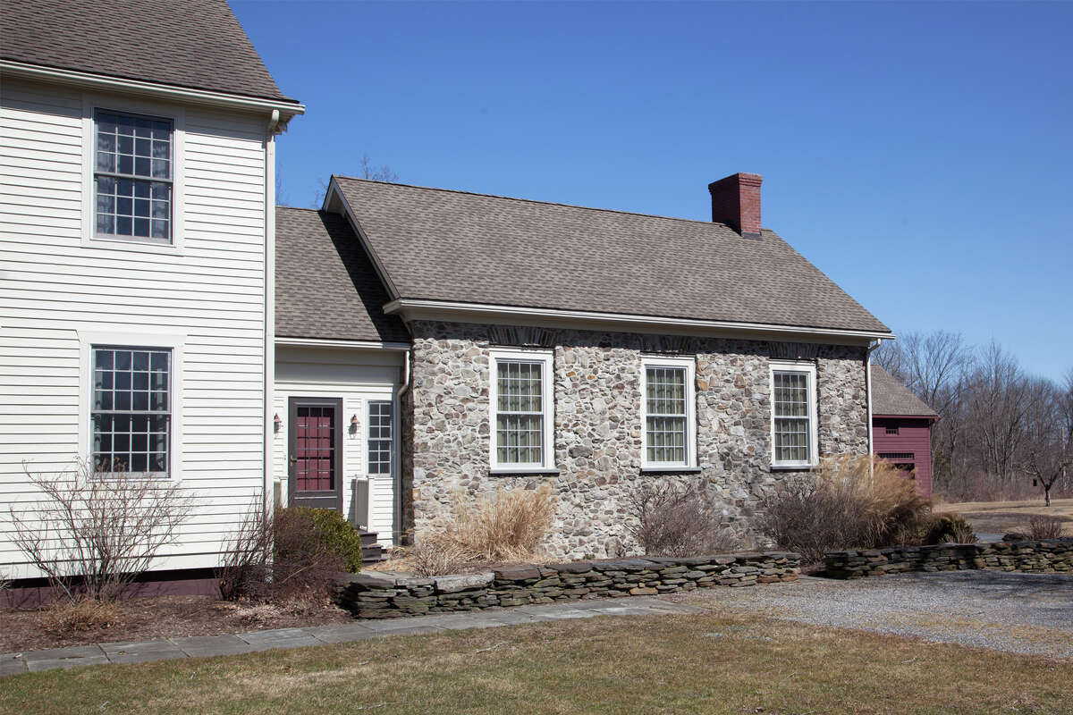 3307 County Route 21, Kinderhook. This week's house is a classic wood clapboard Colonial with a field stone addition. It was built in 1995 on 56 acres. The lot also has on it a barn, a 3-bay carriage house and a cottage. The house has 5,216 square feet of living space. It has four bedrooms and four bathrooms, plus an additional bedroom and bathroom in the guest house. There are six wood-burning fireplaces, a screened porch, a bar in the walk-out basement and a pond lined with willows. Private well and septic, oil heat. Ichabod Crane schools. Taxes: $35,000. List price: $1,995,000. Contact listing agent Mary Stapleton with Berkshire Hathaway HomeServices Blake, Realtors at 518-929-7783.