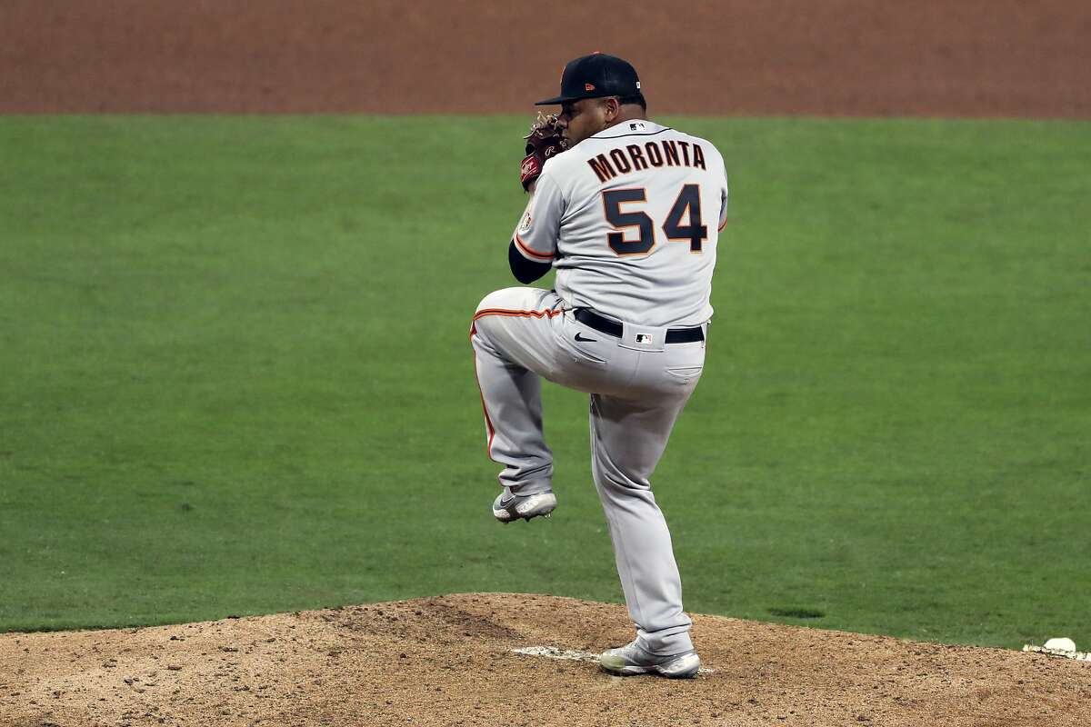 San Francisco Giants relief pitcher Reyes Moronta pitches against the San Diego Padres in the seventh inning of a baseball game, Monday, April 5, 2021, in San Diego. (AP Photo/Derrick Tuskan)