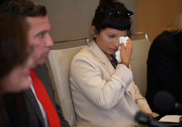 First victim of the sexual assault allegations against Houston Texans quarterback Desaun Watson wipes away tears during a news conference Tuesday, April 6, 2021, in Houston. Photo: Yi-Chin Lee, Houston Chronicle / Staff Photographer / © 2021 Houston Chronicle